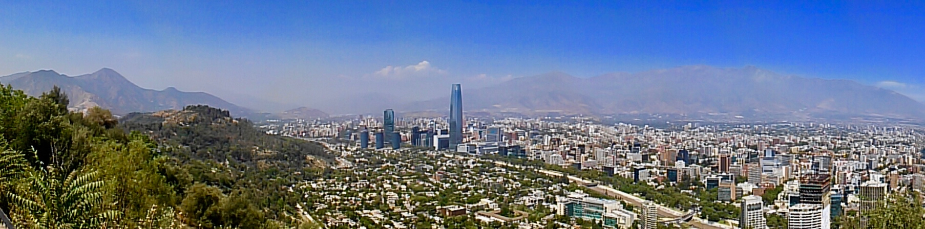 Santiago panorama with park, high rise buildings, and the Andes mountains.