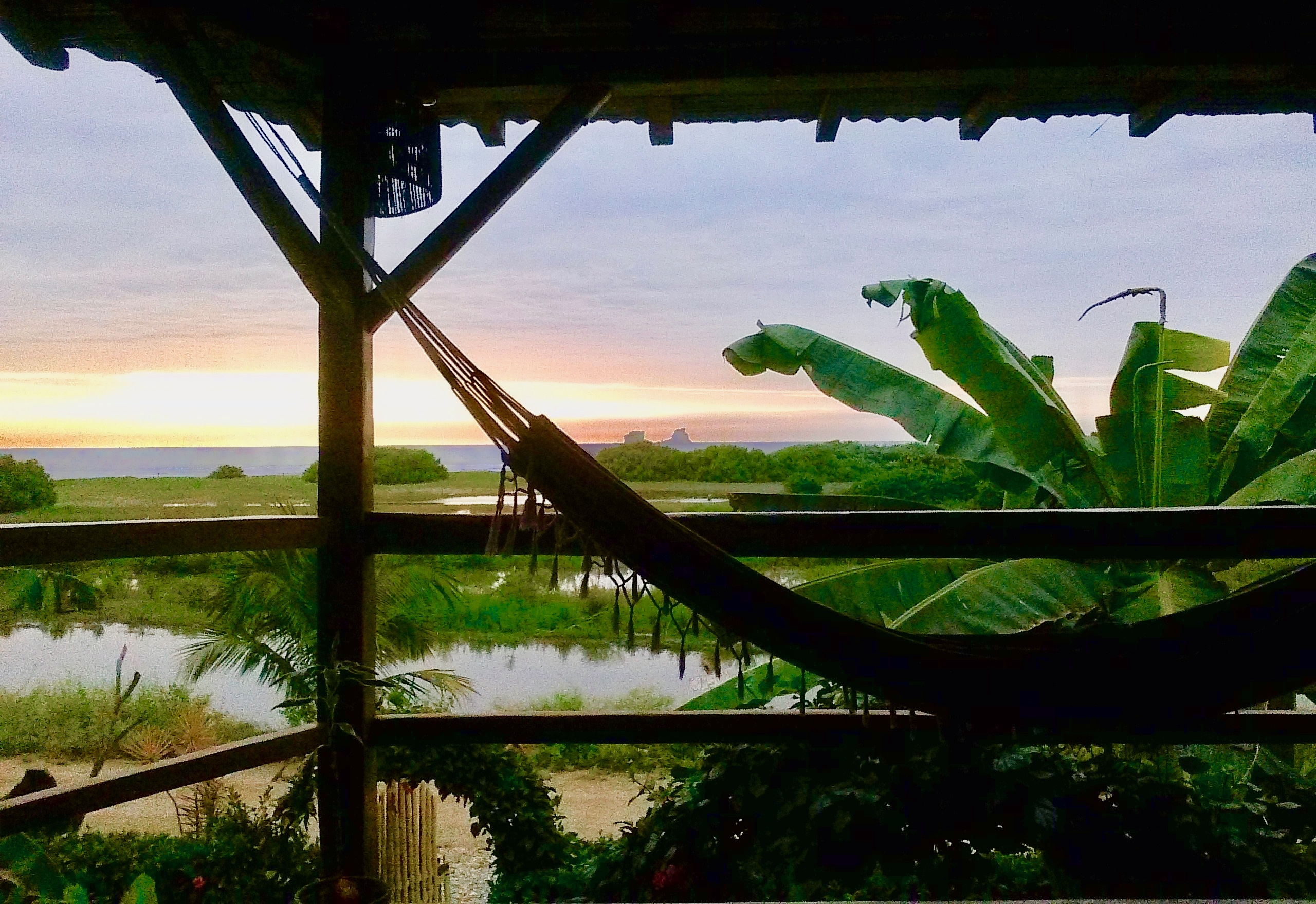 Sunset from our deck, past the lagoon and to the ocean.