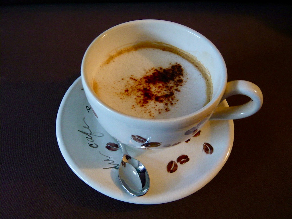 coffee in beautiful cup with spoon