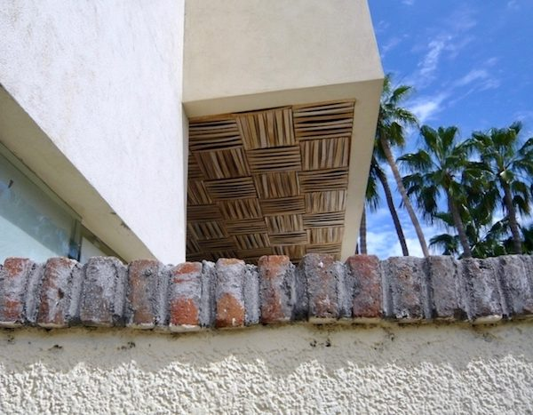Patterns of stucco, bricks, bamboo and palm trees.